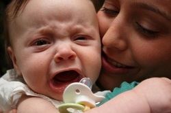 Mother with crying baby.jpg